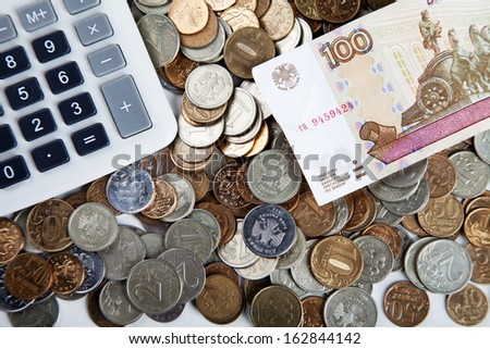coins, ruble banknotes and calculator on white - stock photo