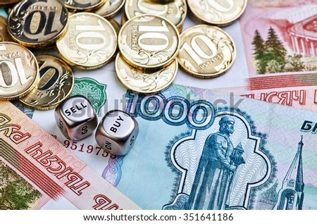 Coins, ruble banknotes and dices cubes. Selective focus - stock photo