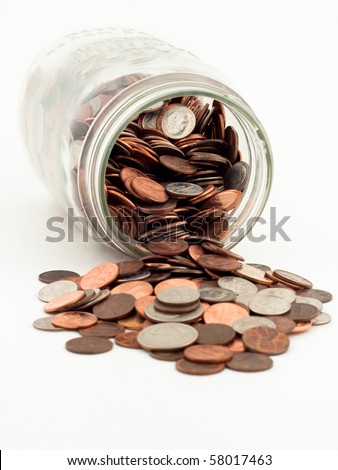 Coins Spilled From Jar - stock photo