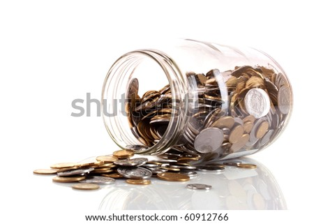 coins spilling from a money jar - stock photo