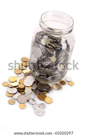coins spilling from a money jar
