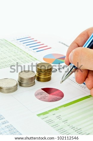 Coins stack and pen on colorful business background - stock photo