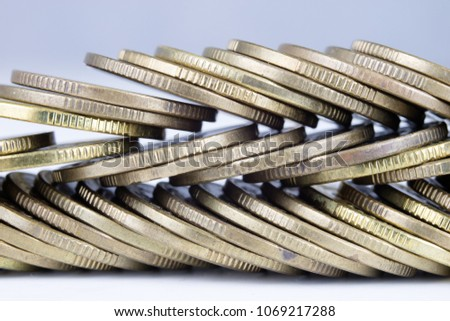 Coins stacked. Money lying on the table. White background.