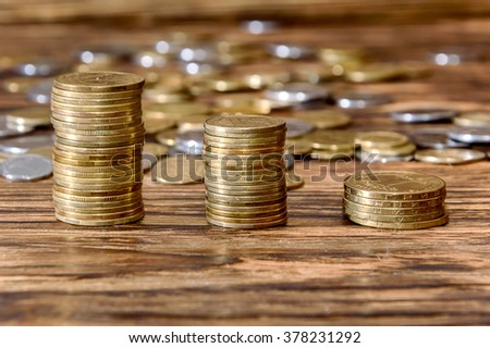 Coins stacked on wood