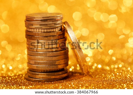 Coins stacks on golden background - stock photo