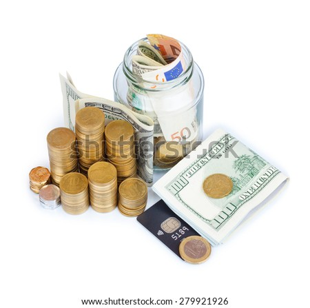 Coins stacks with paper currency and jar full or bills and coins with credit card isolated on white - stock photo
