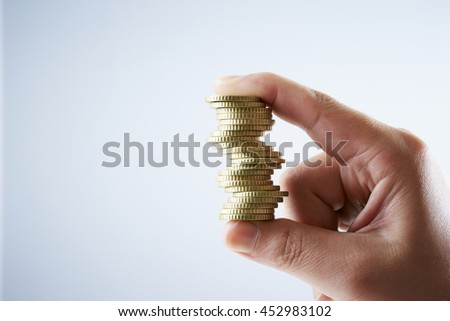 Coins with hand