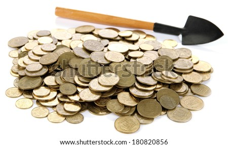 Coins with shovel isolated on white - stock photo