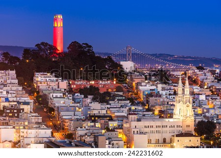 Coit Tower lit up in red and gold in honor of the San Francisco 49ers hosting a 2013 NFL playoff game. - stock photo