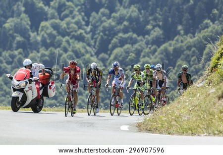 COL D'ASPIN,FRANCE - JUL 15: The breakaway climbing the road to Col D'Aspin  in Pyrenees Mountains during the stage 11 of Le Tour de France on Juy 15, 2015. - stock photo
