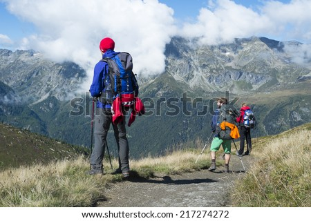 COL DE BALME, FRANCE - SEPTEMBER 01: Backpackers looking at view with Aiguille de Loriaz in the background. The area is a stage of the popular Mont Blanc tour. September 01, 2014 in Col de Balme. - stock photo