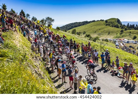 COL DU GRAND COLOMBIER,FRANCE-JUL 17: The peloton riding on the road to Col du Grand Colombier in Jura Mountains during the stage 15 of Tour de France 2016.