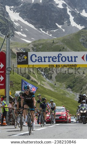COL DU LAUTARET,FRANCE - JUL 19:The Cyclist Geraint Thomas (Team Sky) arrives on mountain pass Lautaret during the stage 14 of Le Tour de France on July 19 2014. - stock photo
