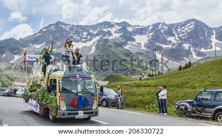 COL DU LAUTARET,FRANCE - JUL 19: The fancy Carrefour Vehicle during the passing of the Publicity Caravan  on mountain pass Lautaret in the stage 14 of Le Tour de France on July 19 2014.  - stock photo