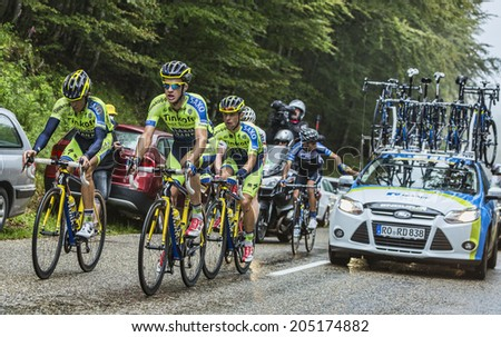 COL DU PLATZERWASEL, FRANCE - JUL 14: Members of the Team Thinkoff - Saxo help Alberto Contador after he crashed to climb to Col du Platzerwasel, during the stage 10 of Le Tour de France on July 14 2014. - stock photo