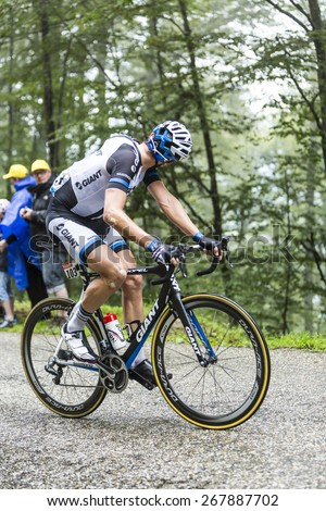 COL DU PLATZERWASEL,FRANCE - JUL 14: The cyclist Koen de Kort of Giant-Shimano Team looking back while climbing the mountain pass Platzerwasel during the stage 10 of Le Tour de France on July 14 2014 - stock photo