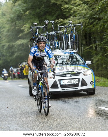 COL DU PLATZERWASEL, FRANCE - JUL 14:The cyclist Tiago Machado of NetApp-Endura, suffering after a crash while climbing the mountain pass Platzerwasel during Le Tour de France on July 14 2014. - stock photo