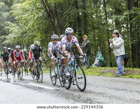COL DU PLATZERWASEL,FRANCE - JUL 14:The German cyclist Tony Martin wearing Polka Dot Jersey climbing the road to mountain pass Platzerwasel, Vosges Mountains,during Le Tour de France on July 14 2014  - stock photo