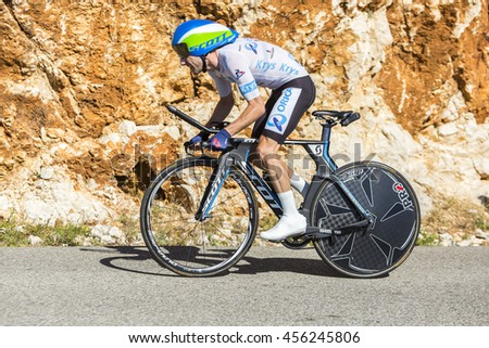 COL DU SERRE DE TOURRE, FRANCE - JUL 15: The cyclist Adam Yates of Orica-BikeExchange Team, in White Jersey, riding jn an individual time trial stage on Col du Serre de Tourre in Tour de France 2016