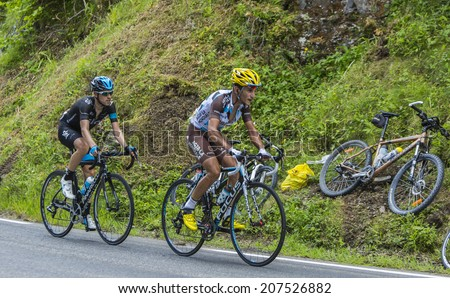 COL DU TOURMALET, FRANCE - JUL 24, 2014:The cyclists Blel Kadri (Ag2r-La Mondiale) and Mikel Nieve Iturralde (Sky) climbing to Col du Tourmalet in the stage 18 of Le Tour de France on July 24, 2014.  - stock photo