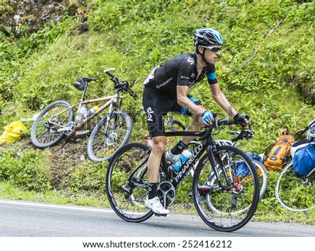 COL DU TOURMALET, FRANCE - JUL 24:The Spanish cyclist Mikel Nieve Iturralde (Team Sky) climbing the difficult road  to Col de Tourmalet in the stage 18 of Le Tour de France on July 24, 2014. - stock photo