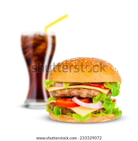 Cola and Big beautiful juicy burger with meat and vegetables. Isolated on white background