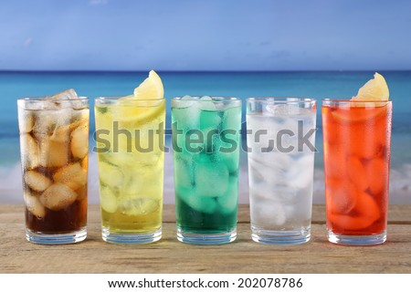 Cola and lemonade soda or soft drinks on the beach - stock photo