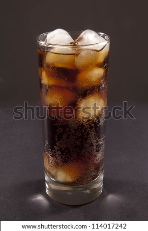 Cola. Coke glass on black background - stock photo