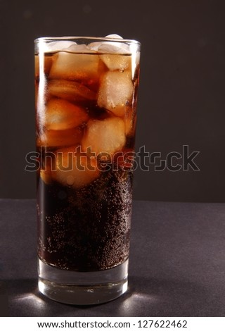 Cola. Coke glass on black background Space for inscription - stock photo