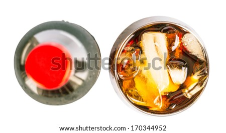 Cola drink in a bottle and short glass with ice cubes over white background - stock photo