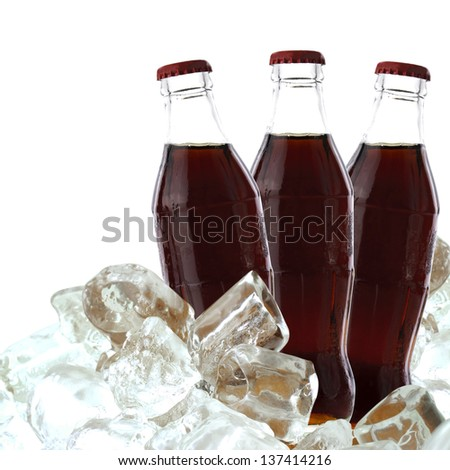 Cola drink with ice on a white background with clipping path - stock photo
