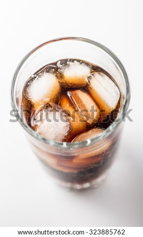 Cola glass with ice cubes on a white background.