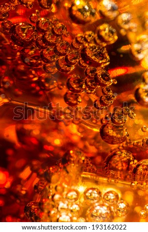 Cola in glass with ice and a bubbles of gas. Macro photo. - stock photo