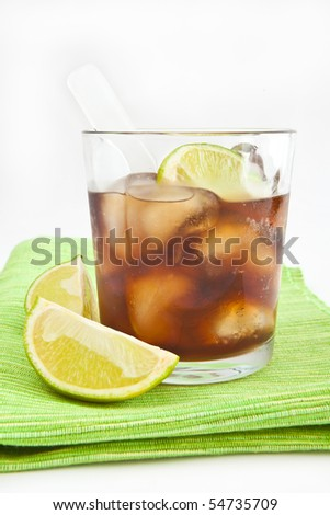 Cola with ice and lime - stock photo
