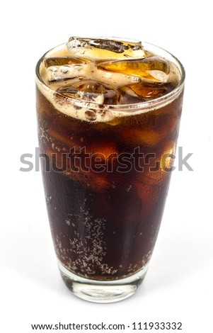 cola with ice on the grass - stock photo