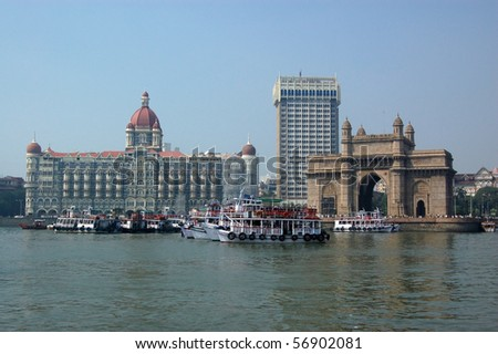 Colaba, Mumbai from the sea A view of the magnificent Gateway to India beside the Taj hotel and Tower hotel viewed from the harbour at Mumbai (formerly Bombay). - stock photo