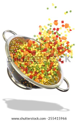 Colander with frozen mixed vegetables isolated on white - stock photo