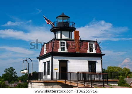 Colchester Reef Lighthouse was painstakingly disassembled, labeled, than reconstructed to its original structure as part of the thirty-seven buildings displayed at the Shelburne Museum. - stock photo