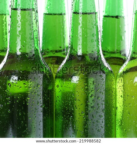 Cold alcohol beer drinks in bottles with water drops