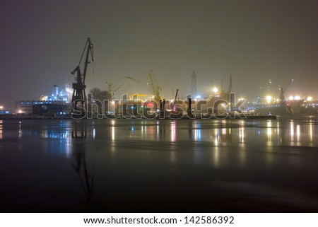 Cold and difficult weather conditions in the Gdansk port. - stock photo