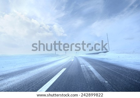 Cold and snowy road  - stock photo