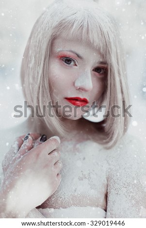 Cold beautiful girl in fairy winter forest with red lips Snow White - stock photo