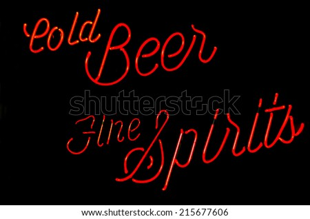 Cold beer and fine spirits neon sign in a bar window - stock photo
