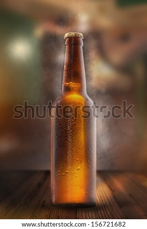 Cold beer bottle with drops, frost and vapour - stock photo