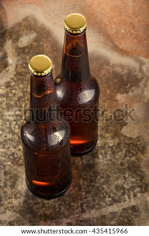 Cold beer bottles. Fresh beer bottles concept.