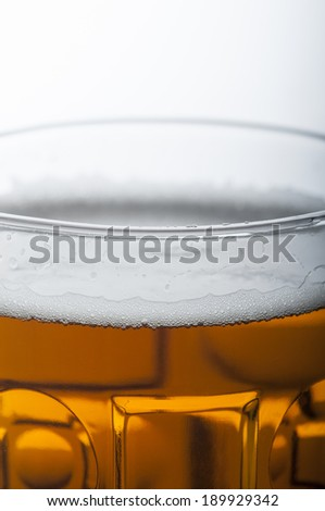 Cold beer in glass on white. macro shot