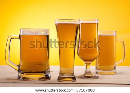 Cold beer on yellow background