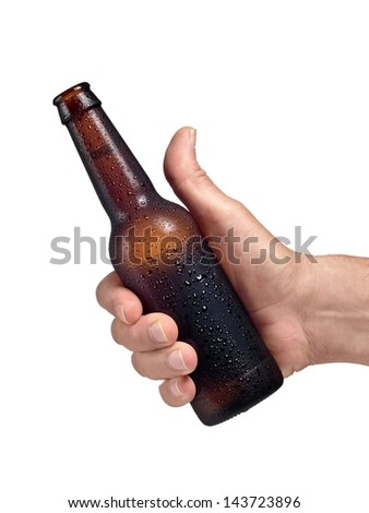 Cold brown beer bottle in a hand