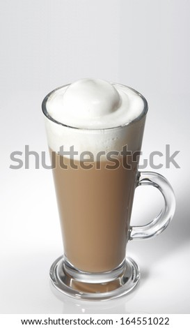 Cold cafe latte in long glass - stock photo