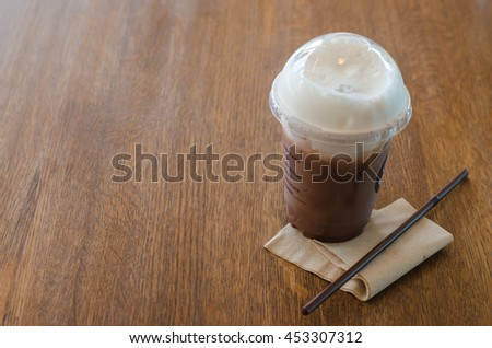 Cold chocolate mocha refreshment drink on wood desk in cafe. - stock photo